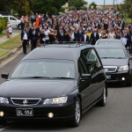 procession set out from the Macksville High School stadium